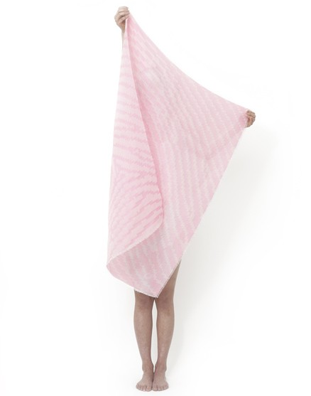 The Changing Identity heat reactive shawl has a pink fingerprint pattern, the color changes in response to heat.